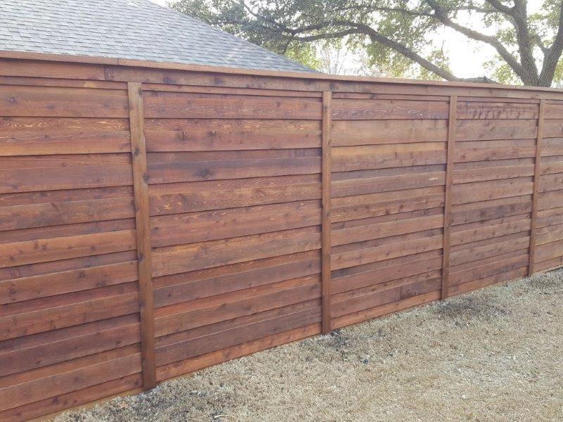 Horizontal Fence Sloped Yard