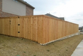 Board on Board Cedar with Stone Retaining Wall